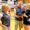 Don Knight | The Herald Bulletin<br /> Alexandria coach Jeff Harmon presents Megan Miller a plaque commemorating her 2000th kill as her mother and assistant coach Deanna Miller looks on  Tuesday.