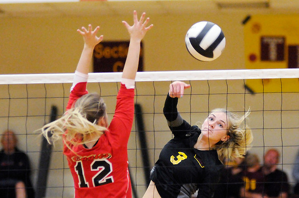 Don Knight | The Herald Bulletin<br /> Alexandria's Megan Miller attacks the ball as Frankton's Gabby Carmack attempts to block her on Tuesday.