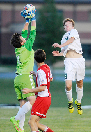 Don Knight | The Herald Bulletin<br /> Anderson's goalie Damon Spaeth clears the ball from in front of the goal and away from Pendleton Heights' Kade Dentel on Wednesday.