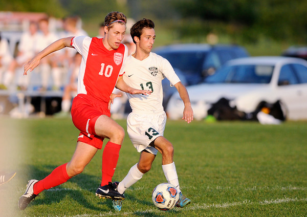 Don Knight | The Herald Bulletin<br /> Anderson's Wes Erny controls the ball as he is pursued by Pendleton Heights' Lucus Tyler as the Arabians hosted the Indians on Wednesday.