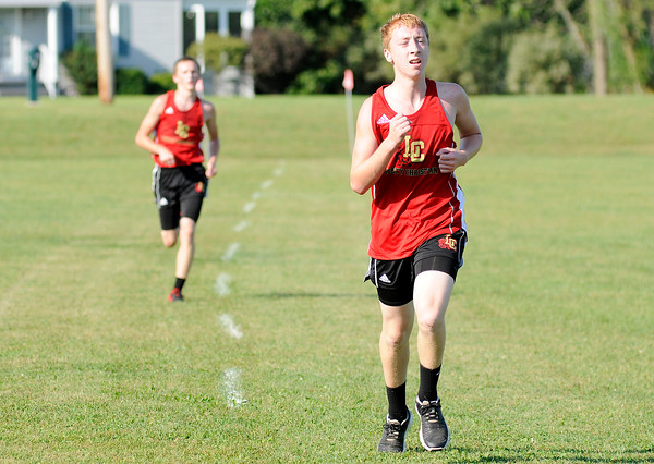 Don Knight   The Herald Bulletin<br /> Brothers Gavin Davis, right, and Trey Davis finish seventh and eighth to help Liberty Christian edge out Anderson 26-29 to win the city cross country meet at Davis Park on Tuesday.
