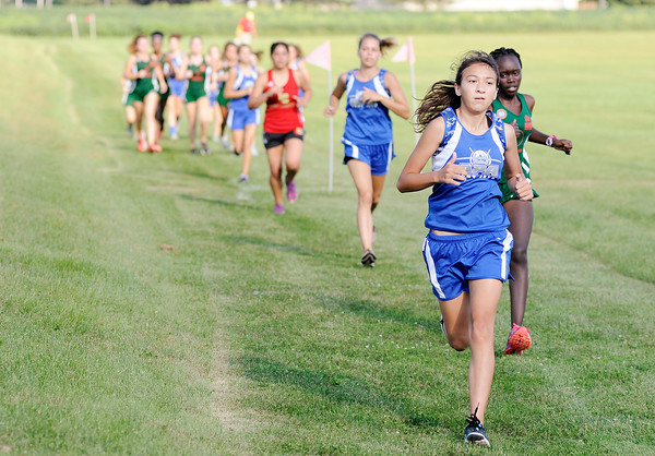 Don Knight | The Herald Bulletin<br /> Teresa Lopez of Anderson Prep leads at the start of the girls city cross country meet at Davis Park on Tuesday. Behind Lopez is Anderson's Sharon Kulali.