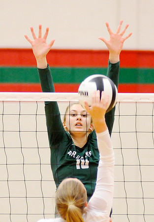 Don Knight   The Herald Bulletin<br /> Pendleton Heights' Gracie King attempts to block a Frankton attack during pool play at the Madison County Volleyball Tournament at Anderson on Thursday.