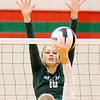 Don Knight | The Herald Bulletin<br /> Pendleton Heights' Gracie King attempts to block a Frankton attack during pool play at the Madison County Volleyball Tournament at Anderson on Thursday.