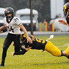 Don Knight | The Herald Bulletin<br /> Lapel's Tanner Mroz breaks a tackle by Shenandoah's Dallas Pugsley on Friday.
