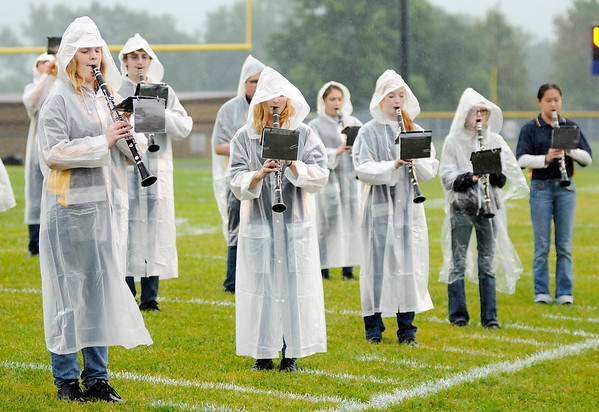 Don Knight | The Herald Bulletin<br /> Shenandoah's band performs the school's fight song as a steady rain fell during the Raiders' game against the Lapel Bulldogs on Friday.