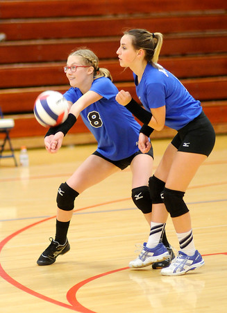 Don Knight | The Herald Bulletin<br /> APA's Samantha Cox passes the ball as Jennalyn McNeal looks on as the Jests faced the Alexandria Tigers in the opening round of the Madison County volleyball tournament at Elwood on Thursday.