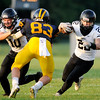 Don Knight | The Herald Bulletin<br /> Lapel running back John Sherwood cuts upfield behind the block of Braxton Kemerly but isn't able to avoid Shenandoah's Austin Zimmer on Friday.