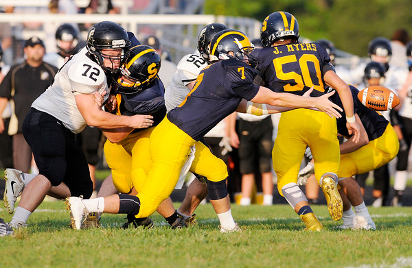 Don Knight | The Herald Bulletin<br /> Shenandoah quarterback Brennen Dowden pitches the ball to his running back as the Raiders  hosted Lapel on Friday.