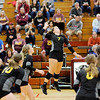 Don Knight | The Herald Bulletin<br /> Alexandria's Blaine Kelly attacks the ball during the Madison County Volleyball championship at Elwood on Saturday.