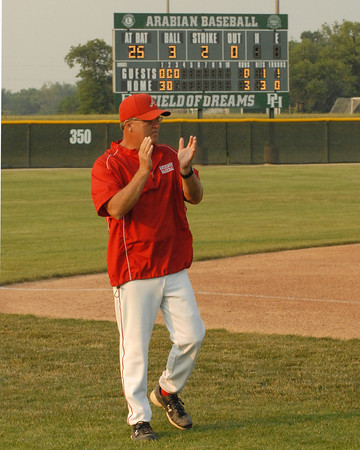 Anderson Indian coach Terry Turner roots the team on in the bottom of the third inning.