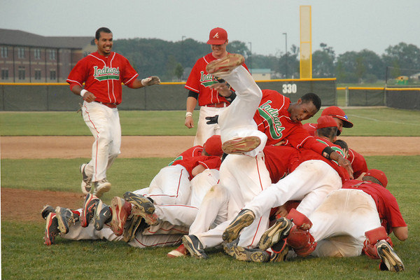 Anderson Indians rush the mound after defeating New Castle 6 to 0 to win the IHSAA Boys' Baseball Sectional at Pendleton Heights.