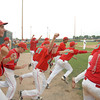 The Anderson Indians bench celebrates after winning the IHSAA Boys' Baseball Sectional at Pendleton Heights.
