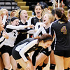 Don Knight | The Herald Bulletin<br /> Alexandria celebrates their sectional championship after defeating Madison-Grant in five sets on Saturday.