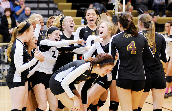 Don Knight | The Herald Bulletin Alexandria celebrates their sectional championship after defeating Madison-Grant in five sets on Saturday.