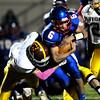 John P. Cleary | The Herald Bulletin<br /> Elwood's quarterback Alex Mireles protects the ball as he runs through the Alexandria line.