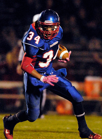 Elwood's Bryce Graves turns up field to gain yardage.