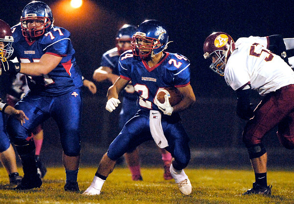 Elwood's Sammy Mireles makes a cut to gain more yards.