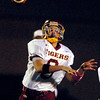 Alexandria's quarterback Blaize Kelly throws to his target.