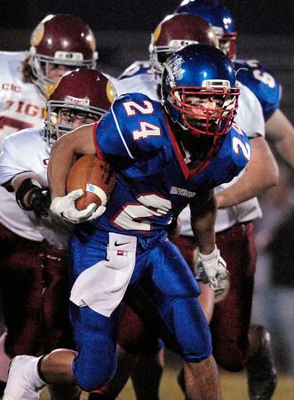 Elwood's Sammy Mireles gains more yards as he breaks into the secondary.