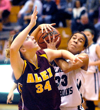 Alexandria's Macie Cox and Pendleton's Kiawna Cottrell fight for a rebound.