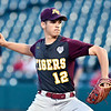 John P. Cleary | The Herald Bulletin<br /> The Alexandria Tigers vs Southridge Raiders in IHSAA 2A Baseball State Championship. Alexandria pitcher Brennan Morehead eyes the plate as he throws the ball.