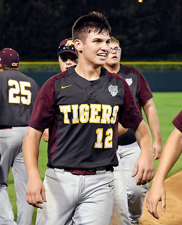 John P. Cleary | The Herald Bulletin Alexandria's pitcher Brennan Morehead is all smiles after scoring the winning run to win the 2A Baseball State Championship.