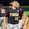 John P. Cleary | The Herald Bulletin<br /> Alexandria's pitcher Brennan Morehead is all smiles after scoring the winning run to win the 2A Baseball State Championship.