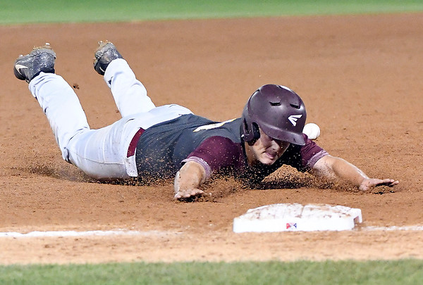 John P. Cleary | The Herald Bulletin<br /> The Alexandria Tigers vs Southridge Raiders in IHSAA 2A Baseball State Championship. Alexandria's Bub Misner slides hard into third base as the ball gets away from the fielder.