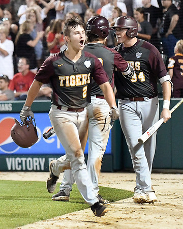 John P. Cleary   The Herald Bulletin<br /> Alexandria's Kole Stewart celebrates after scoring the tying run in the bottom of the seventh inning in the 2A Baseball State Championship game.