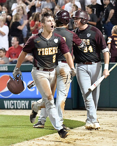 John P. Cleary | The Herald Bulletin Alexandria's Kole Stewart celebrates after scoring the tying run in the bottom of the seventh inning in the 2A Baseball State Championship game.