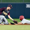 John P. Cleary | The Herald Bulletin<br /> The Alexandria Tigers vs Southridge Raiders in IHSAA 2A Baseball State Championship. Alexandria second baseman Kole Stewart puts the tag on Southridge's Patrick Sander as he attempts to seal second base.