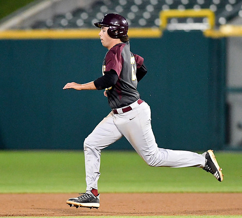 John P. Cleary | The Herald Bulletin<br /> Alexandria's Rylan Metz runs to second base on a grounder during their game against Southridge in the IHSAA 2A Baseball State Championship game.