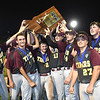 John P. Cleary | The Herald Bulletin<br /> The Alexandria Tigers vs Southridge Raiders in IHSAA 2A Baseball State Championship. The champion Tigers hoist the spoils of their victory high for all the fans to see.