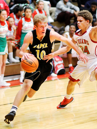 Don Knight | The Herald Bulletin<br /> Lapel's Kamron Herrington drives as he is guarded by Anderson's Dionte Raines as the Indians hosted the Bulldogs on Friday.