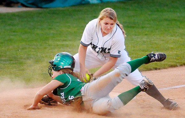 Pendleton Heights' Elizabeth Sigler tags New Castle's Allee Brittnee at as she dives back to third in second round sectional action at Pendleton Heights on Tuesday.