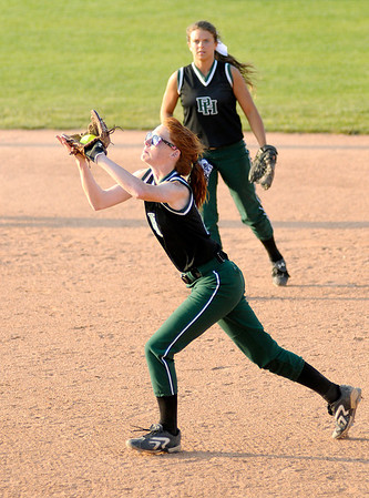 Pendleton Heights' Sarah Dixon catches a fly ball as the Arabians faced Greenfield-Central during the sectional championship on Wednesday.
