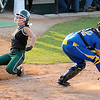 Pendleton Heights' Kinzie Davis slides into home beating the throw to Greenfield-Central catcher Brittany Hardwick during the sectional championship on Wednesday.
