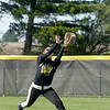 Daleville's Brynn Gooding catches a fly ball in center field.
