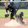 Daleville's Jordyn Marshel beats the tag of Madison-Grant's Katie Kohlmorgen scoring a double.