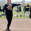 Madison-Grant's Kaycie Pyle throws to first after fielding a bunt.