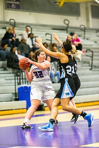 Mary Connell #32 looks to pass the basketball against a agrresive Centreville defense