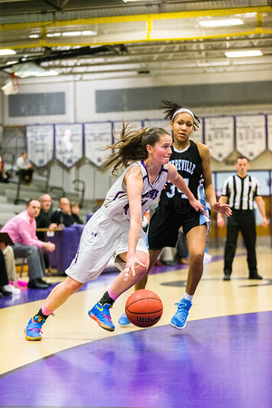 Mary Clougherty #44 dribbles the ball past a Centreville defender