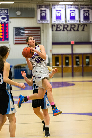 Mary Clougherty #44 goes airborne between two Centreville defenders