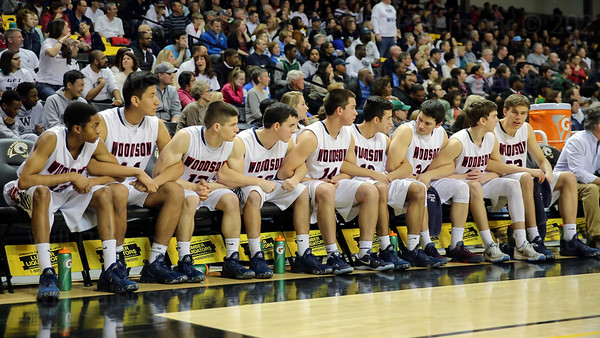 The WT Woodson Cavaliers bond together in the closing momeents of their 55-50 Virginia 6A Championship win over Hylton