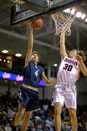 Nicholas Peterson #4 is defended by Woodson's Matthew Urbach #30