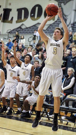 Gavin Kiley elevates for a jump shot in his teams 102-70 win over Lake Braddock.