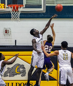 Aaron Opoku #3 rejects the shot of Lake Braddocks Josh Hassett #22