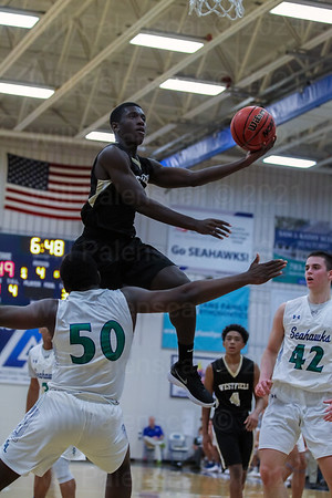Aaron Opoku #3 rises to the hoop