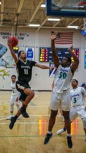 Marshall Reed #11 glides to the hoop